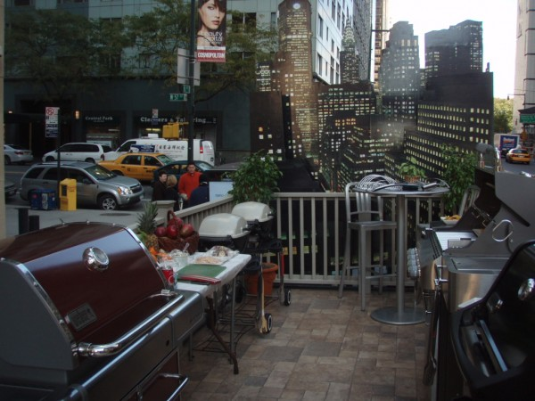 Design of NYC balcony withbackdrop of NYC